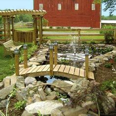 This reader wanted an oasis from which to watch the sun set over the mountains. His ambitious solution: a DIY pond, abutterfly garden and an herb garden, and relaxing area with the hammock. | thisoldhouse.com