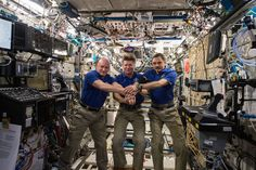 https://flic.kr/p/w5qYTE | iss044e013678 | ISS044E013678 (07/15/2015) --- On July 15, 2015 aboard the International Space Station, Expedition 44 crew memebrs Scott Kelly of NASA (left), Expedition Commander and Russian cosmonaut Gennady Padalka (middle), and Russian cosmonaut Mikhail Kornienko (right) commemorated the 40th anniversary of the joint Apollo-Soyuz mission.