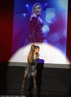 Hand-me-down: Ariana Grande got to raid Madonna's closet for the Queen of Pop's Raising Malawi benefit in Miami Beach on Friday