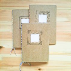hand-stitched notebook with punched-out hole with hand-drawn frames