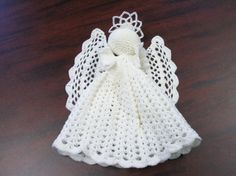 An Adorable Crocheted Angel Tree Topper by TheShopOnBerryLane, $14.00