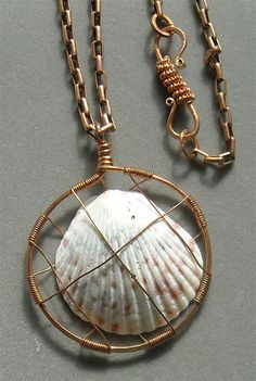Wire-wrapped necklace: A caged shell. Beautiful. I want to make one!  Clasp is interesting, too!