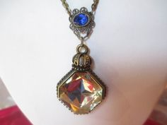 Vintage Chunky Brass Necklace Art Deco Style Exact Age Unknown Crafted Blue and Large Drop Pendant Yellow Multifaceted Acrylic by KulturePop on Etsy