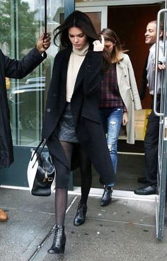 Shop this look on Lookastic:  https://lookastic.com/women/looks/coat-turtleneck-mini-skirt-ankle-boots-tote-bag-tights/5240  — Black Leather Ankle Boots  — Black Tights  — Black and White Leather Tote Bag  — Black Coat  — Black Quilted Leather Mini Skirt  — Beige Turtleneck