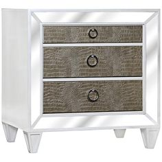 With a mirrored drawer frame and faux croc leather drawer faces, this 3-drawer nightstand adds style and storage to a room.