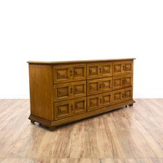 This long dresser is featured in a solid wood with a glossy burl wood finish. This large dresser has 9 spacious drawers, intricate carved trim and brass hardware. Great storage piece that doubles as a buffet credenza!  #bohemian #dressers #longdresser #sandiegovintage #vintagefurniture