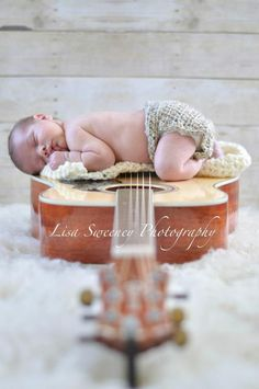 Lisa Sweeney Photography  I want to take newborn pics like this but with a violin instead of a guitar