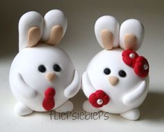 cake topper? with a green tie on the boy bunny and pink flowers for the girl bunny