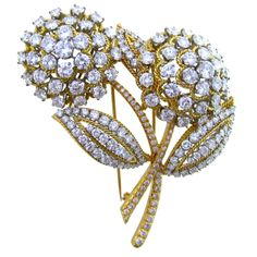 Van Cleef & Arpels Diamond Flower Brooch | From a unique collection of vintage brooches at http://www.1stdibs.com/jewelry/brooches/brooches/