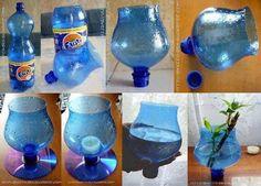 Foto: Reusa las botellas de plástico y viejos cd para hacer floreros en forma de copa. Water Bottle Crafts, Reuse Plastic Bottles, Plastic Bottle Crafts, Recycled Bottles, Water Bottles, Recycled Crafts, Diy And Crafts, Xmas Crafts, Diys
