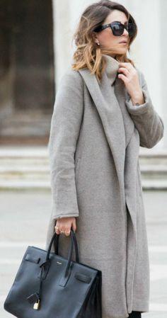 Nicoletta Reggio is wearing a grey coat and sweater from Zara