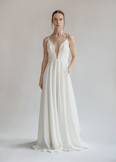 "Aesling | ""Orenda"" Available at Sash & Bustle #sashandbustle #aeslingbridal #canadiandesigner #crepegowns #crepeweddingdress #alineweddingdress #bridalgowns #classicweddingdress #chicweddingdress #alinecrepeweddingdress #shoplocal #sustainableweddingdresses #weddingdresswithpockets #deepvweddingdress #plungingnecklineweddingdress #uniqueweddingdress #modernweddingdress #minimalistweddingdress"