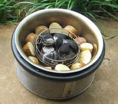 potatoes cooked in the mote of the Cobb Portable Charcoal Grill