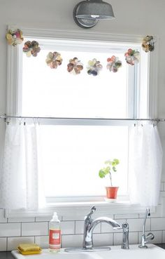 Recycle old magazines by crafting a flower garland. Shannan Martin (flowerpatchfarmgirl.com) brings seasonal flair to her home by draping the handmade pieces above doorways and windowpanes. More blogger ideas we love: http://www.midwestliving.com/homes/seasonal-decorating/7-spring-blogger-projects-we-love/?page=6