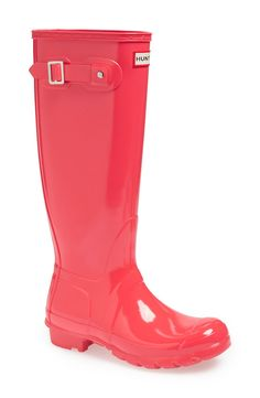 Keeping warm and dry this fall with fun pink Hunter gloss rain boots.