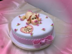 1st Birthday Cake Puppy - The cake was made for an adorable little girl and the parents loved it so much they refused to cut it and have still got the cake displayed in a perspex box.