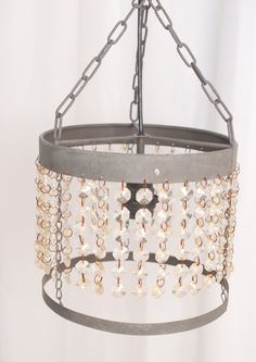 Vintage Steel and Glass Crystal Chandelier Hanging Lamp. Adding strings of color would make the room simmer.