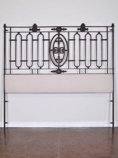 Antique French iron balcony surround repurposed into a tremendous king size head board.
