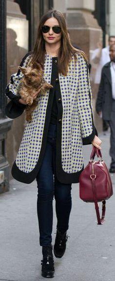 Who made Miranda Kerr's aviator sunglasses, skinny jeans, blue coat, black boots, and red handbag?