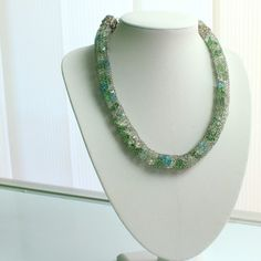 """Unique Design Collar -Handmade Collar from """" Vlora Shileku"""".A wonderfully elegant piece of jewelry made from glass beads( green, grey and blue) and wire. The beads are all wrapped with wire, also both ends have an unique design made from wire.  Material: Wire and glass beads."""