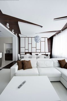 White and brown decor Dramatic All White Renovated Apartment in Moscow by Vladimir Malashonok