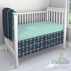 Crib bedding in Solid Seafoam Aqua Minky, Solid Navy, Solid Emerald Turquoise, Navy Anchors. Created using the Nursery Designer® by Carousel Designs where you mix and match from hundreds of fabrics to create your own unique baby bedding. #carouseldesigns