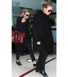 @Who What Wear - Mary-Kate and Ashley Olsen                 As you already know, the Olsens know how to wear all-black, and this stands true in other areas of dress, including travel! Ashley opted for loafers, cropped jeans, and a sleek coat, while Mary-Kate chose boots, skinny jeans, and an oversized coat. With crocodile bags in tow and sunglasses on, they proved (yet again) that black never goes out of style.  Get Mary-Kate's Look: Nasty Gal Coletta Coat ($120); Marciano Skinny Jean No. 61…