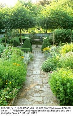 Wiltshire country garden with box hedges and summer perennials