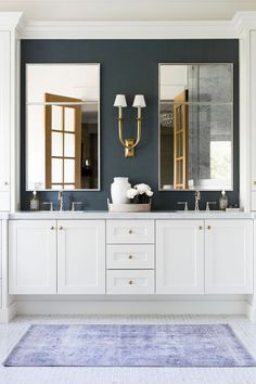Traditional master bath with open doors and dark navy wallpaper, double sconce, double vanity | Studio McGee Design
