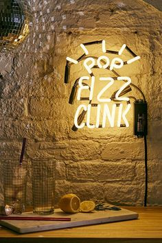 """'Urban Outfitters """"Pop Fizz Clink"""" Neon Sign.'"""