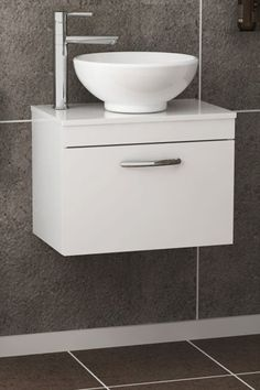 Wall hung vanity units are the best options for space saving with reasonable price range. Counter-top basin add up elegance. Check now! ............................................................................................................................................#VanityUnit #BathroomDesign #WallHungCountertopUnit