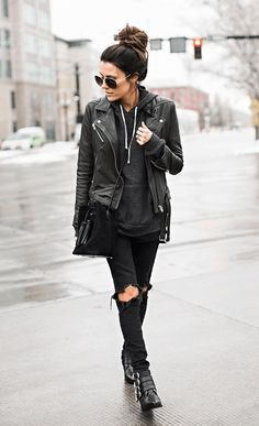 All black rock n roll look. Not much of once for ripped jeans but I do like her hair, shades, leather jacket and boots