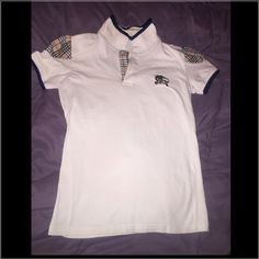 Burberry woman shirt Very nice white  stretchy with Burberry shoulders design 100% authentic size medium is being used like two times look at the pictures before you make any offers or buy it Burberry Tops Tees - Short Sleeve