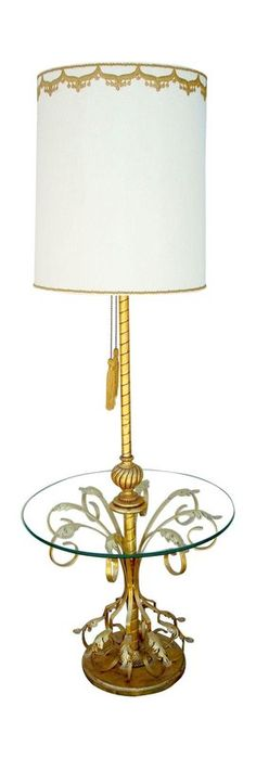 Vintage 1960s gorgeous gilded floor lamp with ornate details and an attached glass table. Features a textured shade with embroidered embellishments, 2 lightbulbs and tassel pull switches. In excellent cond...