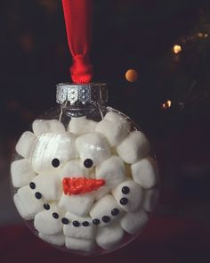 Clear plastic ornament, mini marshmallows, puffy paint for the face..... I think I would use cottonballs inside instead of the marshmallows ;)
