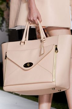 Nude always goes with any outfit. We can't resist a Mulberry handbag.