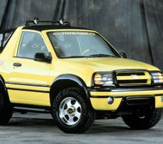 Chevy Geo Tracker -  loved seeing her drive around in this car with my grandson Drey.  Another standard transmission!