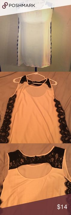 Lane Bryant cream and black top with lace Cream top with black lace accents. Cute back with 3 faux buttons. Size 14/16. Very good condition. Lane Bryant Tops Blouses