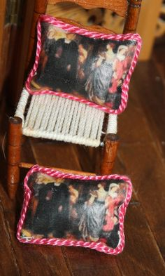 Pair of OOAK arts and crafts era Kate Bunce miniature doll house cushions made by transferring image to fabric.  http://stores.ebay.com/happyharvesterminiatures