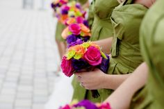 Loving the bright floral bouquets against the muted green bridesmaid dresses.    Photo:  Jen Lynne Photography