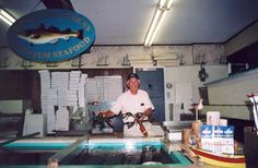 Keith Marden at the Lobster Tanks at Captain Marden's Seafood in Wellesley