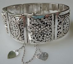 Nice modern Chinese export silver filigree Four Seasons hinged bracelet.