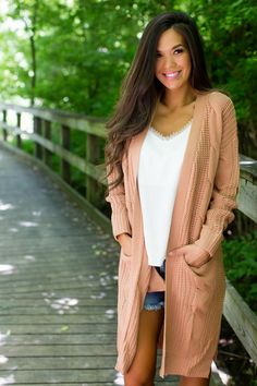 Adorable apricot cable knit long cardi with long sleeves, pockets, open front, and small side slits. Made to have a relaxed fit, the model is shown wearing a small. Made of acrylic fabric. Dottie Couture Boutique, Cable Knit, Kimono Top, Sweaters, Tops, Women, Fashion, Moda, Fashion Styles