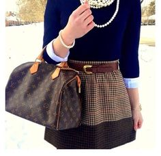 brown patterned skirt, light blue button down, navy blue sweater, pearls, purse