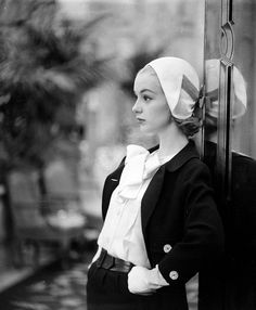 Silk-wool Spring suit with silk blouse by Ben Zuckerman, hat by Sally Victor, photo by Gordon Parks, 1957