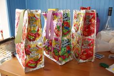 *Recycled Juice Pouch Lunch Bag - This is a great inexpensive project to do with and for your kids! They learn about recycling and reusing things they would normally throw away and have the added bonus of having something cool for school. (I made purses like this by making them bigger, lining them, and adding a strap - kids love them!)