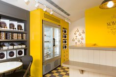 nomili Patisserie coffee shop designed by dana shaked yellow wall checkers floor with brown colors french style עיצוב בית קפה פטיסרי דנה שקד