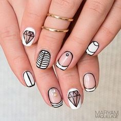 Modern Black & White stripes utilizing negative space and studs nail art:
