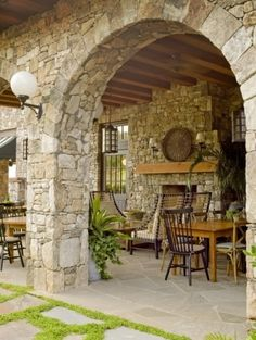I love this rustic stone archway.  Considering duplicating in in a stone coat on a dining room wall, with a Tuscan mural.