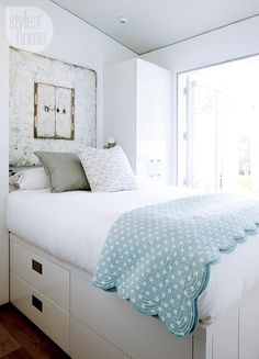 If there's no room for a closet or set of drawers in the bedroom, look to captain's beds as a storage solution. And if you need a bit more height and drawer space underneath, go the custom route and build up.